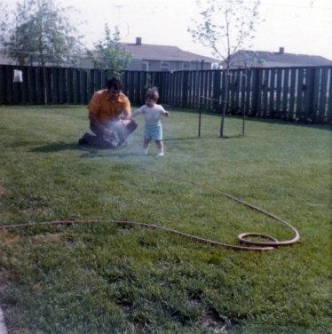 Dad and I watering the grass, 1972