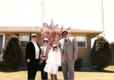 The family in front of the house for Beth's first communion - 1982
